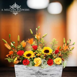 Vista frontal del Arreglo floral magia sobre caja vintage